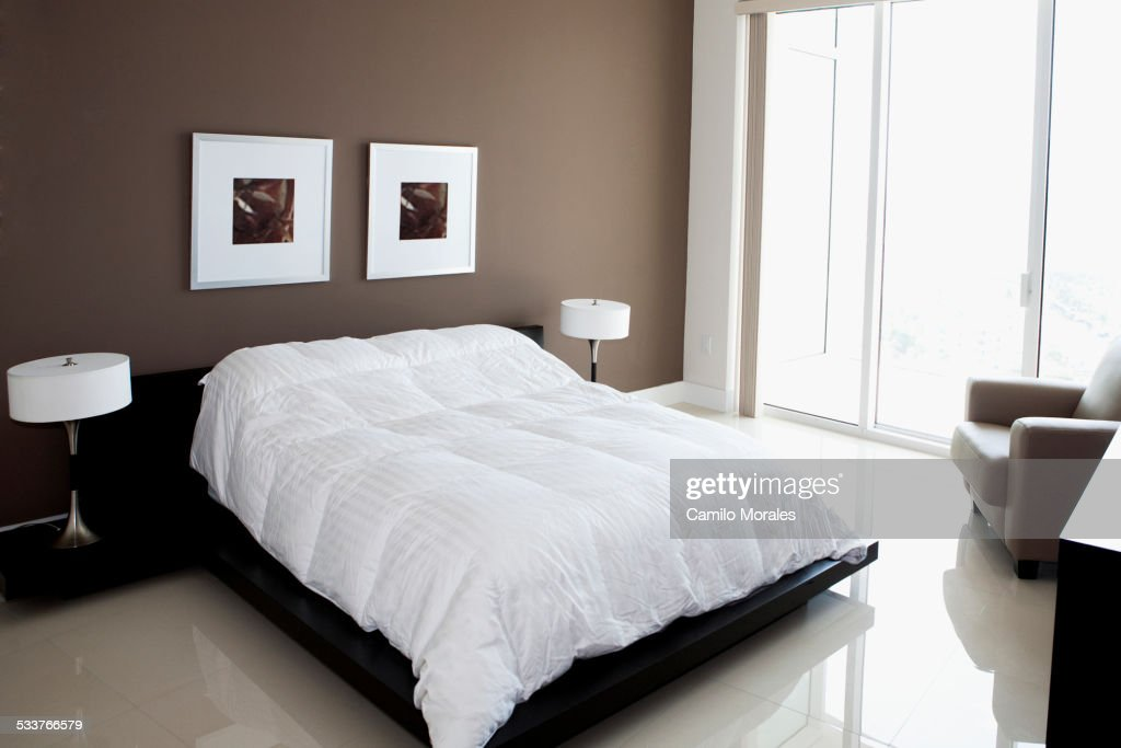 Bed Wall Art And Windows In Modern Bedroom Stock Photo ...