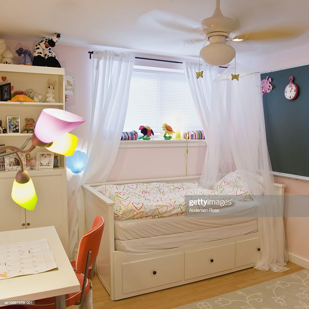 Bed With Decoration And Study Table : Stock Photo