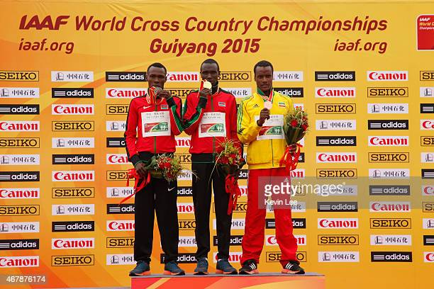 Bedan Karoki Muchiri of Kenya Geoffrey Kipsang Kamworor of Kenya and Muktar Edris of Ethiopia pose ojn the podium after the senior men's race at the...