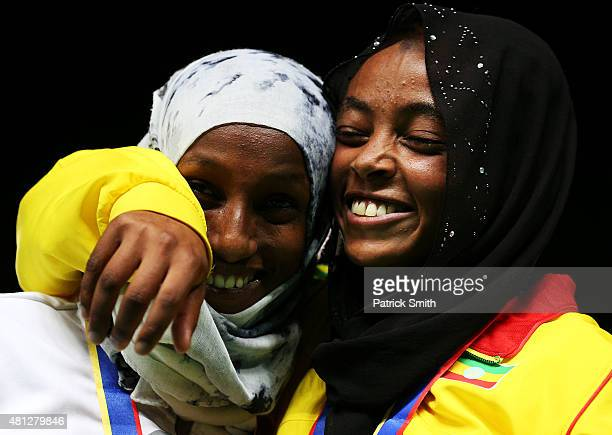 Bedatu Hirpa of Ethiopia gold medal celebrates with Dalila Abdulkadir Gosa of Bahrain silver medal on the podium after the Girls 1500 Meters Final on...