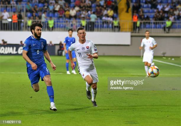 Bedavi Huseynov of Azerbaijan in action against Robert Bozenik of Slovakia during a UEFA Euro 2020 European Championship Qualifiers Group E match...