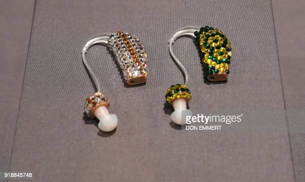 Bedazzled and Bejeweled Earring Aids making a fashion statement are displayed as part of the AccessAbility exhibit at the Cooper Hewitt Smithsonian...