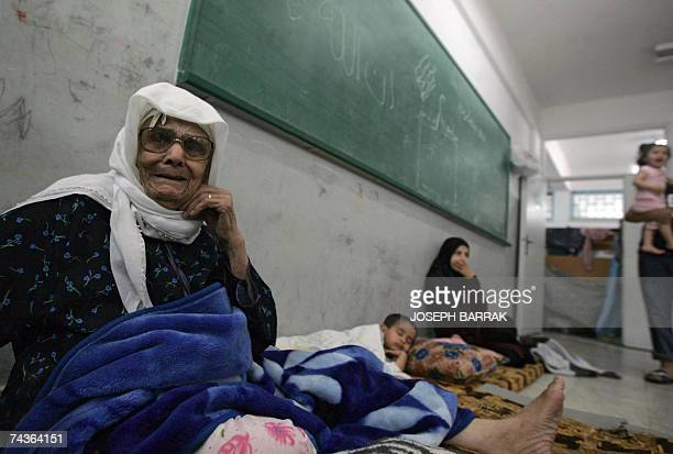 Amina Omar who fled the Palestinian besieged refugee camp of Nahr alBared sits at a school's classroom at the adjacent refugee camp of Beddawi in...