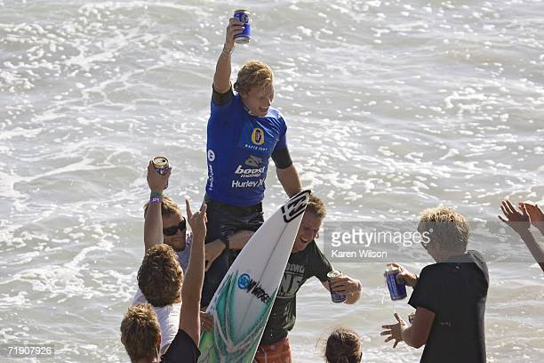 Bede Durbidge of Gold Coast Australia is carried up the beach by his Aussie comrades moments after he clinched the Boost Mobile Pro September 16 2006...