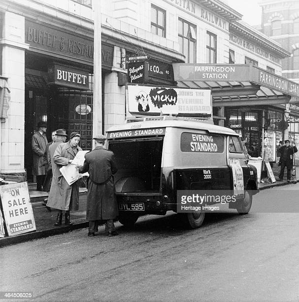 Bedford CA van delivering the Evening Standard London 1958 A Bedford van delivers papers to a newspaper seller outside Farringdon underground station...