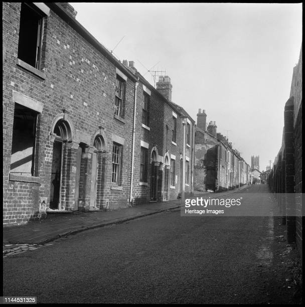 Bedford Street Shelton StokeonTrent 19651968 A view looking east along the derelict terraced houses of Bedford Street with the boundary wall of the...