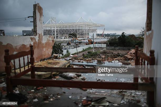Bedframe remains in a partially demolished home in the Vila Autodromo 'favela' community, with the Olympic Aquatics Stadium construction ongoing in...