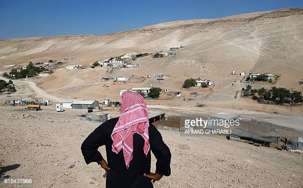 Bedouin Abu Youssef alJahalin stands on top of a hill looking towards his home in the Bedouin village of Wadi Abu Hindi near the Israeli occupied...