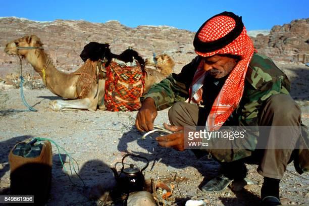 Bedouin camel guide are preparing the tea for the tourists Petra Jordan