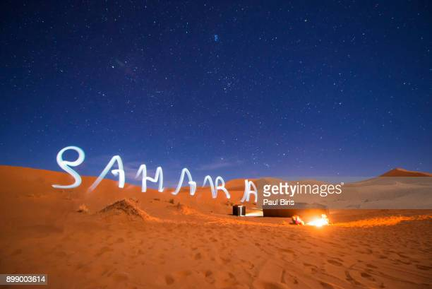 bedouin camp in the moroccan sahara in merzouga, morocco - merzouga stock pictures, royalty-free photos & images
