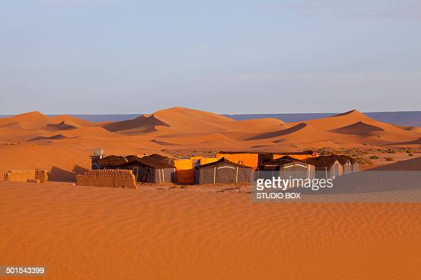 Bedouin camp site in the desert, red sand dunes
