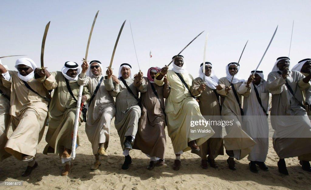 Bedouin Dancers Perform War Dance Near Iraqi Border In Kuwait : News Photo