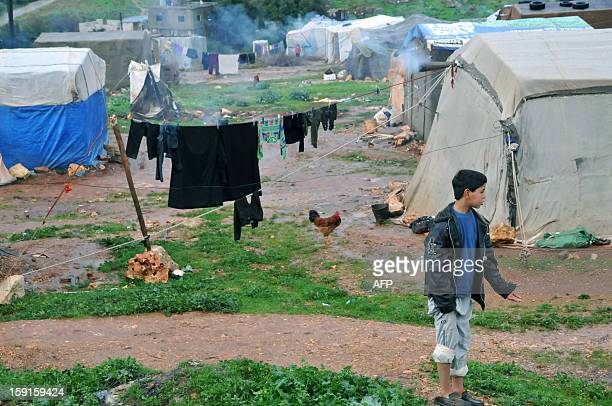 Bedouin families from Syria who have taken refuge for the winter in Lebanon are seen camped close to the village of Kfarkahel in the Koura district...