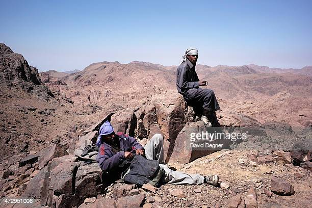 Bedouin guide stands on the top of Mount Katherine, part of a group leading tourists hiking through the mountains of South Sinai on April 18, 2015...