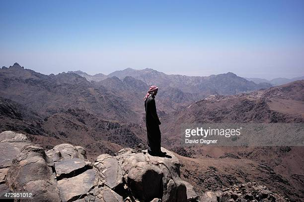 Bedouin guide stands on the top of Mount Katherine part of a group leading tourists hiking through the mountains of South Sinai on April 18 2015 near...