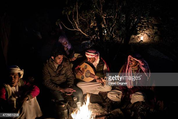Bedouin guides play the oud and sing around the dancefire at night while leading tourists hiking through the mountains of South Sinai on April 17...