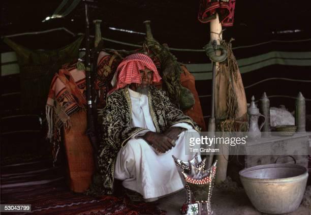 Bedouin man in his Bedouin tent in the desert at Riyadh in Saudi Arabia In front is an incense burner