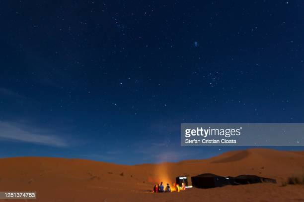 bedouin night at the camp, with music and dancing, erg chebbi sand dune, morocco - night safari stock pictures, royalty-free photos & images