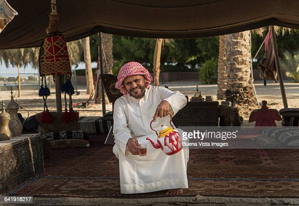 bedouin pouring tea - bedouin stock pictures, royalty-free photos & images