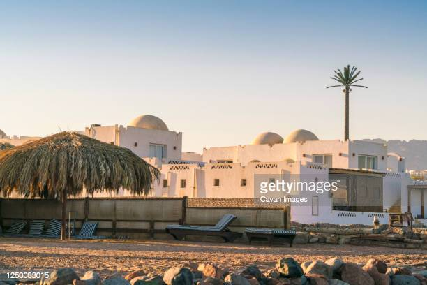 bedouin style tourist resort in dahab with sunbathing decks - tourism in south sinai stock pictures, royalty-free photos & images