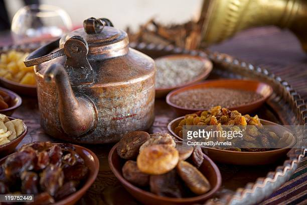 bedouin tea, nuts and dried fruit - ramadan stock pictures, royalty-free photos & images