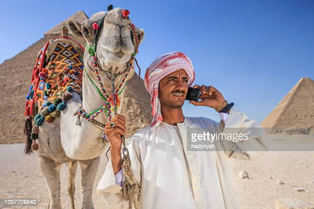 bedouin using phone, cairo, egypt - north africa stock pictures, royalty-free photos & images