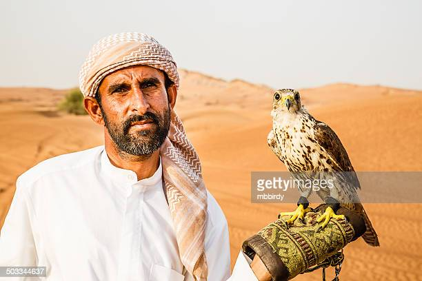 bedouin with falcon - bedouin stock pictures, royalty-free photos & images