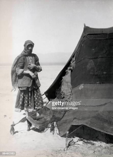 """Bedouin woman by her tent, probably Turkey. From: """"Frauentrachten im Vorderen Orient"""" by Ludwig von Kummer. Photography. Around 1925. [Mit Tuch..."""