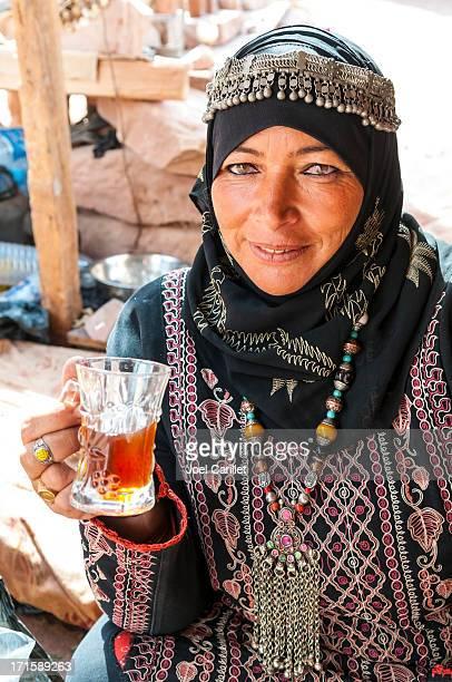 Bedouin woman drinking tea in Petra, Jordan