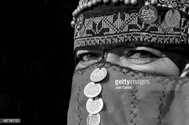 bedouin woman with traditional veil in petra, jordan - bedouin stock pictures, royalty-free photos & images