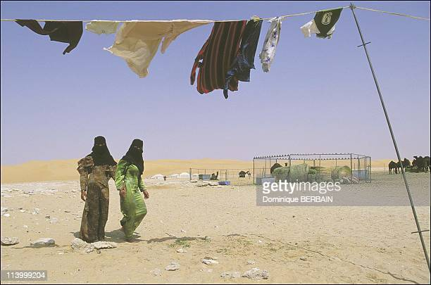 Bedouin women of the Rub al Khali desert the largest desert in Saudi Arabia In February 2003Bedouin camp young women washing the family laundry They...