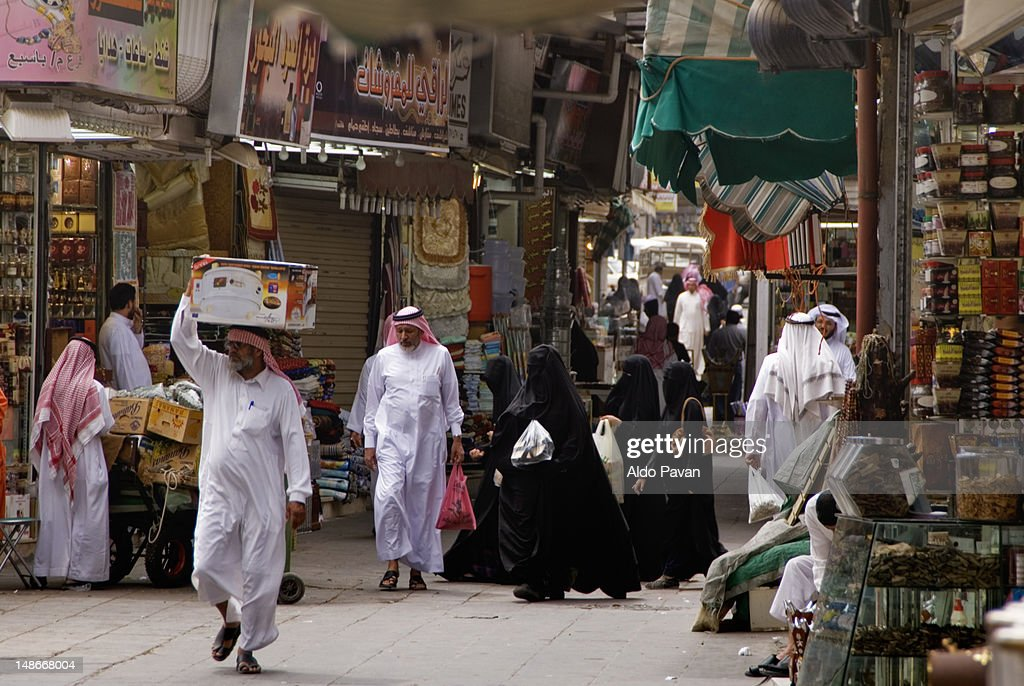Bedouins and veiled women at the market. : Stock Photo