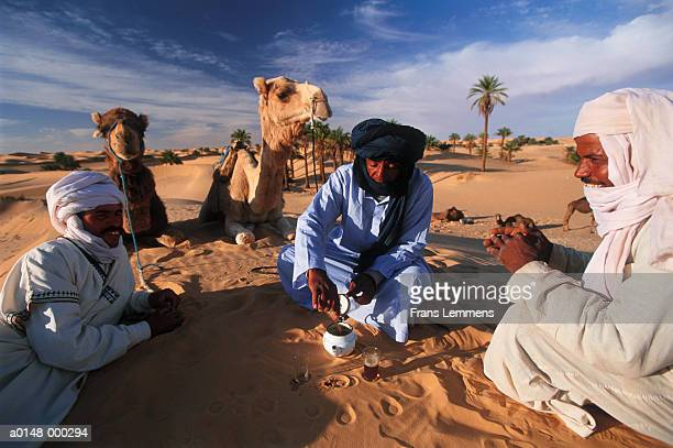 bedouins drinking tea - bedouin stock pictures, royalty-free photos & images