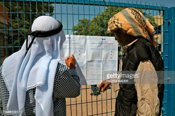 Bedouins from the Negev search for their names outside a polling station in Shaqib alSalam near the southern Israeli city of Beersheva during the...