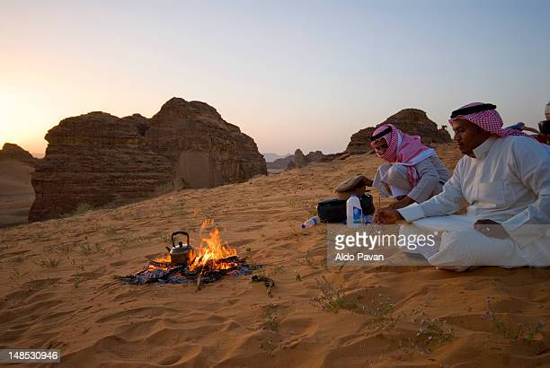 Bedouins making evening tea in the desert near Al Ula oasis.
