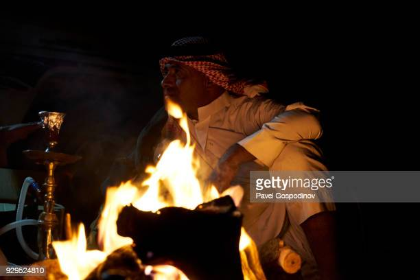 Bedouins preparing  sheesha (water pipe) for smoking in the evening in in Wadi Rum (The Valley of the Moon), a protected desert wilderness in Jordan