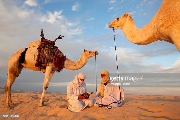 Bedouins reading the Coran in the Sahara