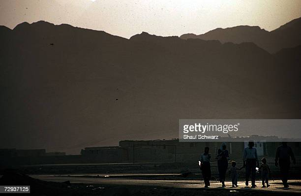 Bedouins walk in Dahab near the Sinai Desert in Egypt. Most bedouin groups in Sinai rely on tourism, which is declining in the area. Bedouins are...