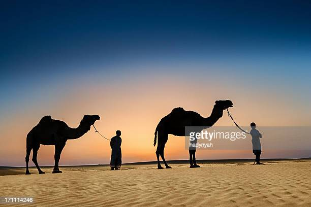 Bedouins with camels on Western Sahara Desert in Africa