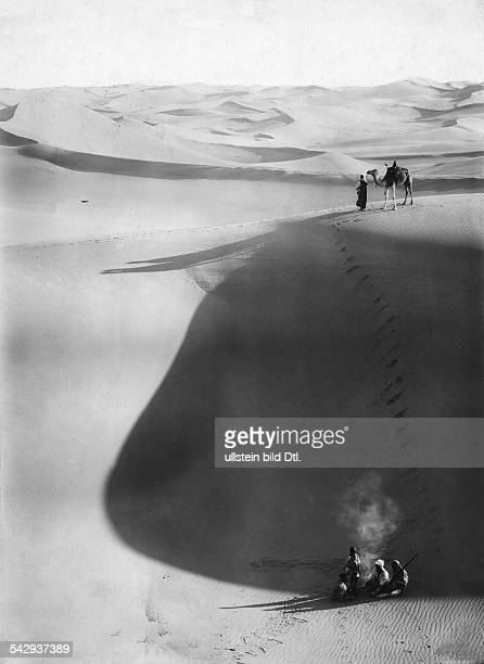 Bedouins with their camels in the desert Sahara Vintage property of ullstein bild