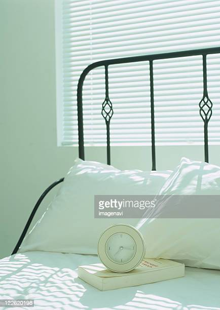 Bed,pillows and alarm clock