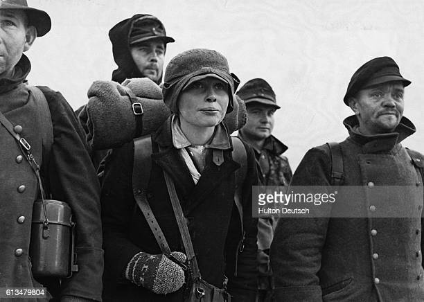 A bedraggled group of German soldiers return home after the disbandment of the Wehrmacht Some returned from Siberia on foot and arrived in Berlin...