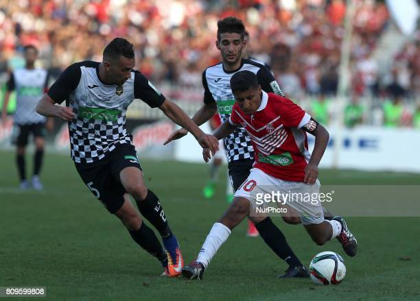 Bedrane Abdelkader of ESS struggle for the ball with FehamBouazza of CRB during final match of Algeria 2017 CR belouizdad against ES setif at the...
