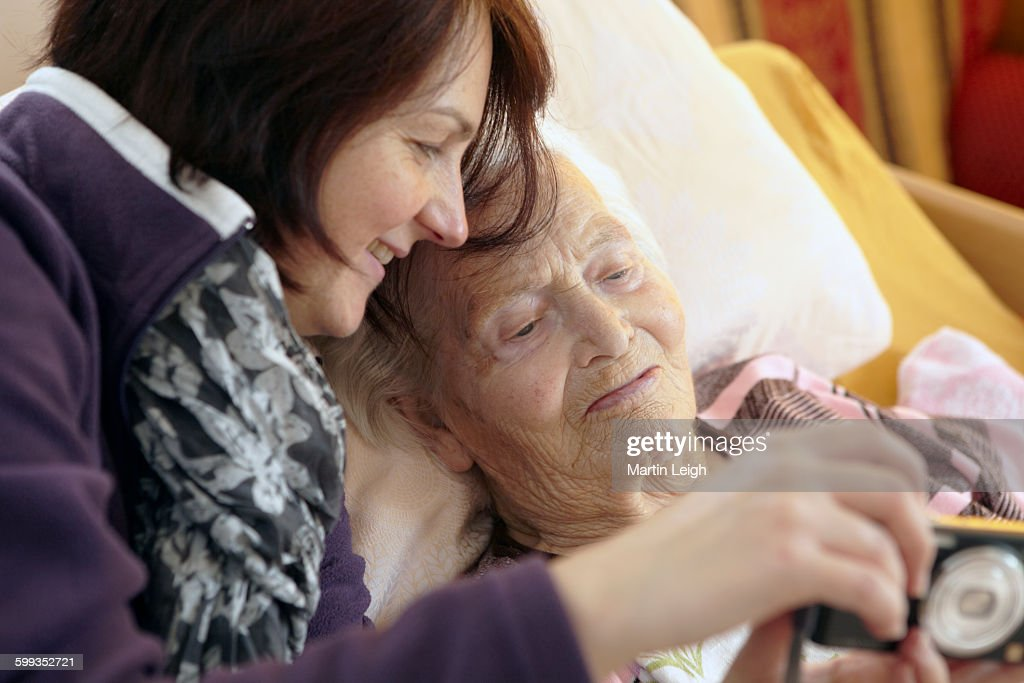 bedridden grandmother with granddaughter : Stock Photo