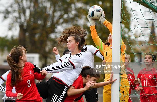 Bedriye Cam of Turkey challenges Gianna Rackow of Germany during the UEFA Under17 Girl's Euro Qualifier between U17 Girl's Turkey and U17 Girl's...