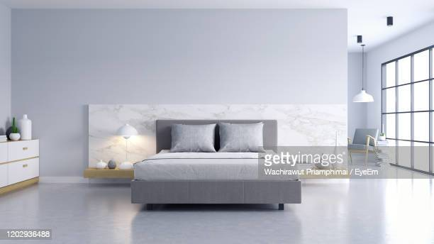bedroom and modern loft style ,bed with polished concrete floor and white wall - hotel stock pictures, royalty-free photos & images