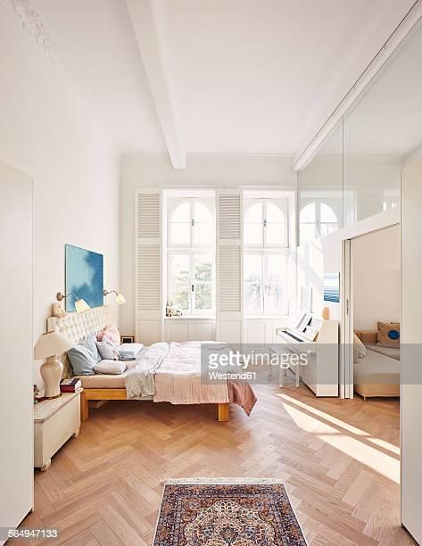 bedroom in a refurbished old building with dining table in the foreground - dormitorio habitación fotografías e imágenes de stock