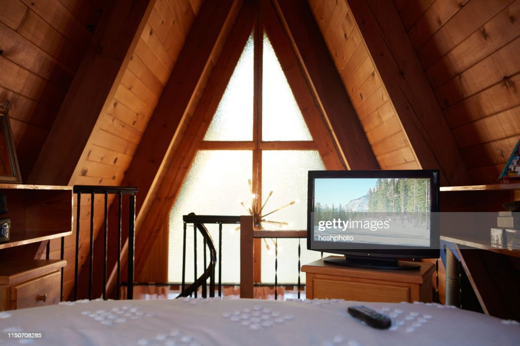 Bedroom in A-frame house : Stock Photo