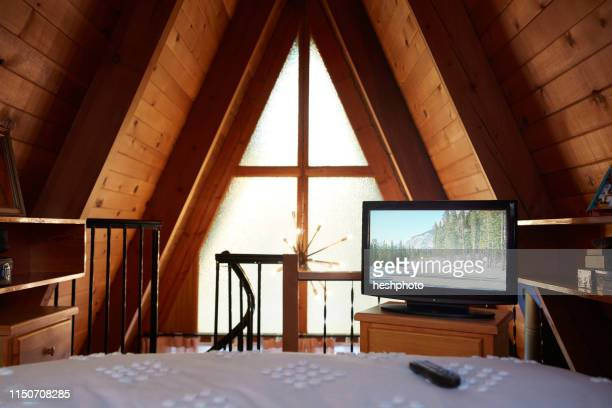 bedroom in a-frame house - heshphoto stock pictures, royalty-free photos & images