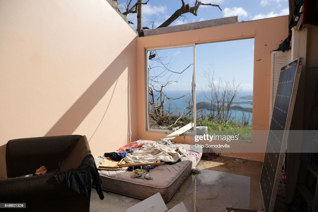A bedroom in the home Tristan Joseph shares with his mother, fiance and cousin lays exposed to the elements after the roof was ripped away by Hurricane Irma September 17, 2017 in Charlotte Amalie, St Thomas, U.S. Virgin Islands. Hurricane Irma slammed into the Leeward Islands on September 6 as a Category 5 storm, killing four and causing major damage on the islands of St. John and St. Thomas.
